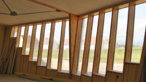 Knapp - konstrukcje słupowo-ryglowe i elewacje drewniano-szklane